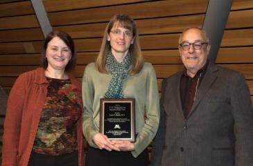 Dr. Lynn Eberly and Award Plaque